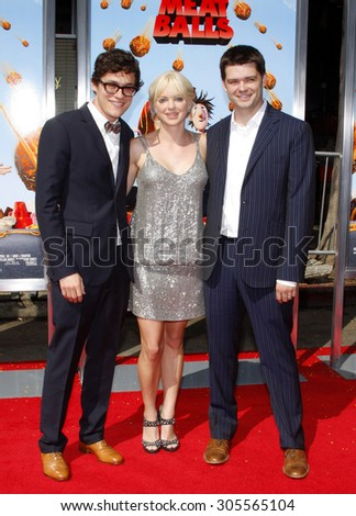 """September 12, 2009. Phil Lord, Anna Faris and Chris Miller at the Los Angeles premiere of """"Cloudy With A Chance Of Meatballs"""" held at the Mann Village Theater, Los Angeles. - stock photo"""