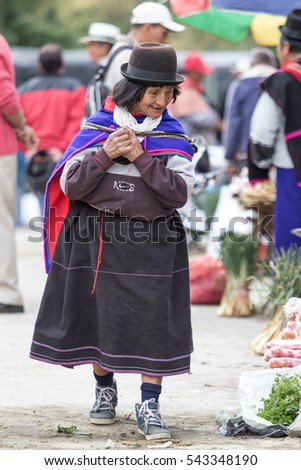 September 6, 2016 Silvia, Colombia: Guambiano woman  walking outdoors wearing traditional clothing