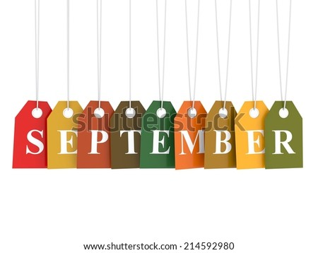September tag on colored hanging labels. Fall colors - stock photo