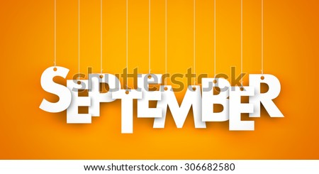 September - text hanging on the strings - stock photo