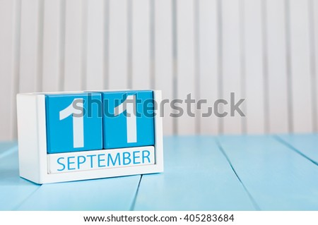 September 11th. Image of september 11 wooden color calendar on white background. Autumn day. Empty space for text - stock photo