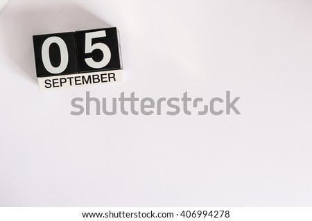 September 5th. Image of september 5 wooden table calendar on white background. Autumn day. Empty space for text - stock photo