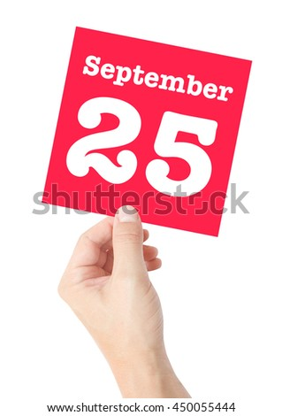 September 25 written on a card held by a hand