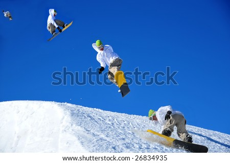 sequence of a snowboarder coming in to land during a high jump. This is a composite image shot in the chronological order of left to right