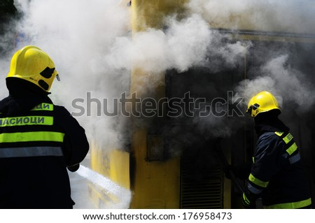 SERBIA, BELGRADE - APRIL 27, 2012: Bus on fire on the street in the middle of the day. More than have of the buses in Belgrade are older than 10 years