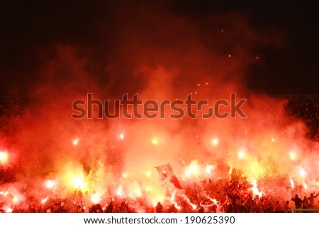 SERBIA, BELGRADE - APRIL 27, 2014: Football fans during eternal rivals have met 146th times in the Eternal soccer derby, FC Partizan and Red Star from Belgrade, was played on 27 April in Belgrade. - stock photo