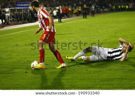 SERBIA, BELGRADE - APRIL 27, 2014: Mijailovic in a duel with Drulovic. Eternal rivals have met 146th times in the Eternal soccer derby, FC Partizan and Red Star from Belgrade, was played on 27 April