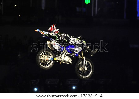 SERBIA, BELGRADE - APRIL 6, 2013: Motorbike rider performing the trick at Masters of dirt show, most thrilling and spectacular freestyle motocross show