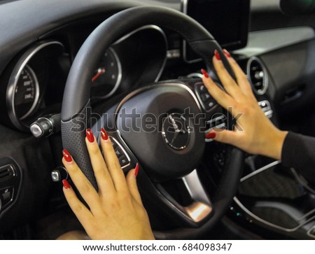 Serbia; Belgrade; April 2, 2017; Woman hands touching Mercedes-Benz steering wheel; the 53rd International Motor Show in Belgrade from March 24th to April 2nd, 2017.
