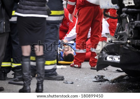 SERBIA, BELGRADE - MART 10, 2013: Injured driver in car accident with participation of trucks and trams at the intersection on New Belgrade - stock photo