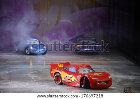 SERBIA, BELGRADE - NOVEMBER 1, 2013: Disney/Pixar CARS race across the ice at Disney on Ice show / cartoon hero - stock photo
