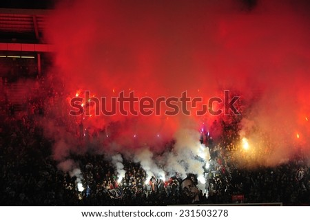 SERBIA, BELGRADE - SEPTEMBER 20, 2014: Soccer or football fans celebrating goal using pyrotechnics during Serbian championship soccer game between Red Star Belgrade and Novi Pazar Football club - stock photo
