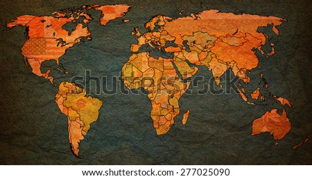 serbia flag on old vintage world map with national borders - stock photo