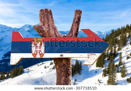 Serbia Flag wooden sign with winter background - stock photo