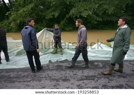 SERBIA, SREMSKA MITROVICA - MAY 17: The army and citizens raise the walls banks with sandbags.The water level of Sava River remains high in worst flooding on record across the Balkans on may 17, 2014