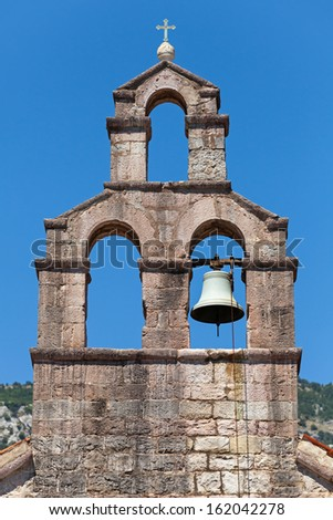 Serbian Orthodox Church bell tower in Petrovac town, Montenegro - stock photo