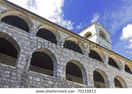 Serbian Orthodox monastery in in Centinje, Montenegro with a blue sky - stock photo