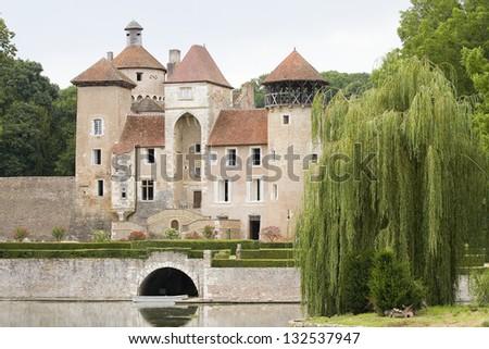 SERCY, FRANCE - AUGUST 23: View of Sercy castle, a famous castle near Tournus built around 12th century, on August 23, 2012, in Sercy, Burgundy region, France.