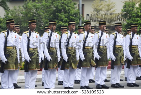 SEREMBAN, MALAYSIA -AUGUST 31, 2016: Malaysia Malay soldier with full traditional Malay army uniform and weapon. Official marching for high command during Malaysia Independence Day parade 2016.