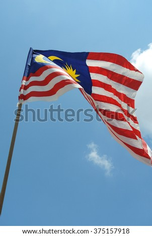 SEREMBAN, MALAYSIA AUGUST, 2014: Malaysian Flag in windy air on August 17, 2014 at Seremban, Negeri Sembilan, Malaysia.