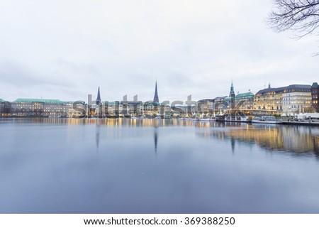 Serene cityscape landscape scene. Long exposure, blurry sea/river/lake water. Hamburg,  Germany. - stock photo