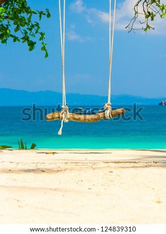 Serene Contemplation Seaside Swing - stock photo