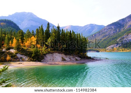 Serene lake in the Canadian Rocky Mountains during autumn - stock photo