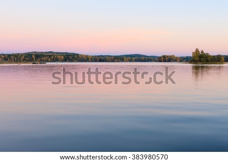 Serene lake scenery at dusk in Finland - stock photo