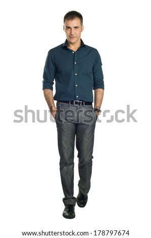 Serene Man Walking With Hand In Pocket Isolated On White Background - stock photo