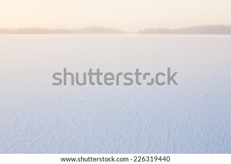 Serene winter morning view to frozen lake - stock photo
