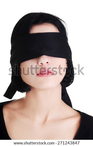 Serene woman with black band on eyes.