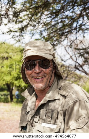 SERENGETI NAT. PARK TANZANIA MAY 22 2013: Mr. Thomas Sztanek a professional african wild life photographer on safari.