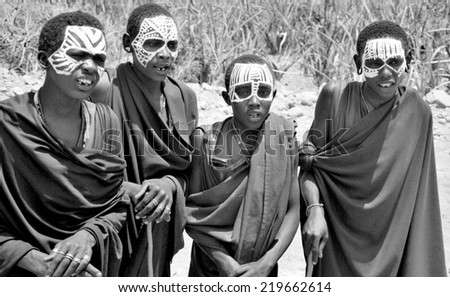 SERENGETI- TANZANIA - OCTOBER 20: Unidentified Young Masai men (Moran) wear black and markings for several months following their circumcision on October 20, 2011 Serengeti Tanzania. - stock photo