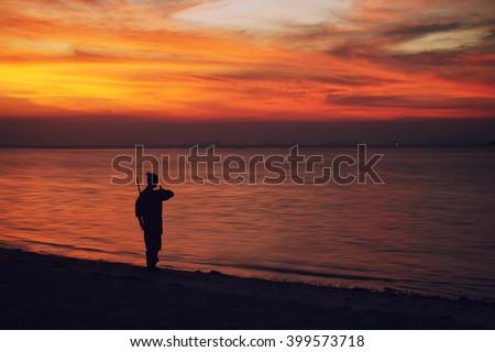 serenity and yoga practicing at sunset, meditation.Twilight in Thailand ,Koh Phangan island - stock photo