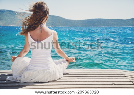 serenity and yoga practicing at the sea - stock photo