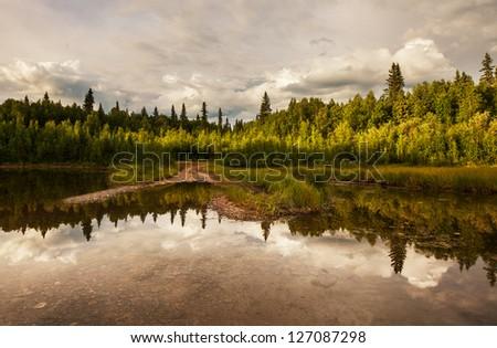 Serenity lake in tundra on Alaska - stock photo