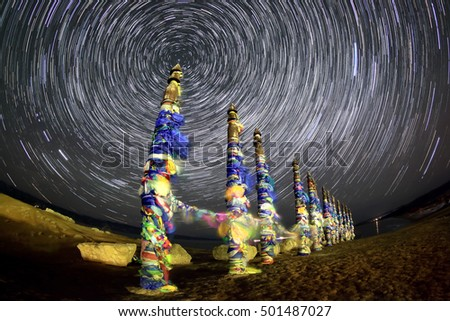 Serge Poles. Starry night over the island Olkhon. Burkhan Cape, Olkhon island, Lake Baikal, Irkutsk region, Russia.