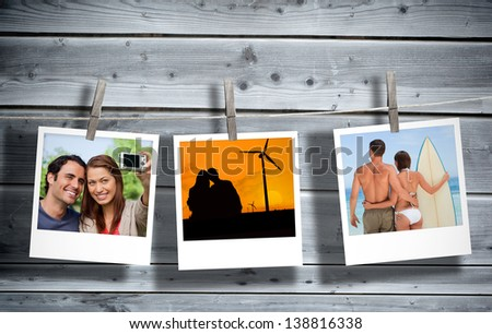 Serial instant photos of holiday scenes hung with a peg in line with wooden boards on the background - stock photo