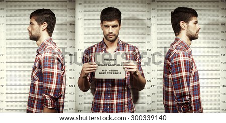 Serial killer mugshot in police office - stock photo