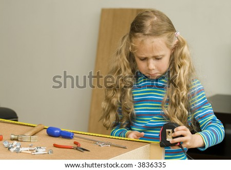Series - girl helping to assemble a new furniture. - stock photo
