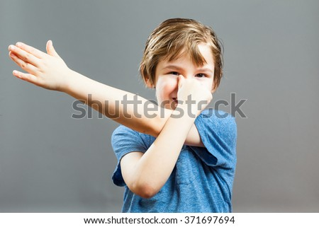 Series of a Little Boy, Expressions - Playing Tricks with his hands and fingers - stock photo