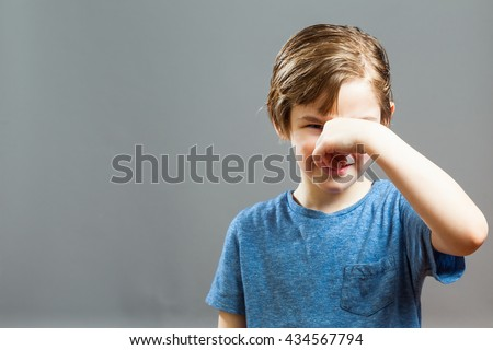 Series of a Little Boy, Expressions - Something Stinks, Holding his Nose - stock photo