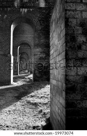 Series of archways under railway bridge, North London, England, UK - stock photo