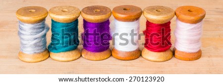 series of colorful sewing thread - stock photo