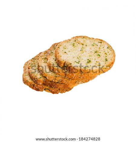 Series of round rusks with spices isolated on white background - stock photo