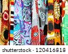 Series of textile fabric samples, all with bold ethnic graphics and designs, great colorful background with varying depth of fields. - stock photo