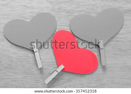 Series of Valentines Card. Red heart paper cut with clothes pin on wooden background. Image of Valentines day. Selective Color. - stock photo