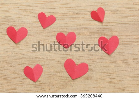 Series of Valentines Card. Seven Red heart paper cut on wooden background. Image of Valentines day. - stock photo