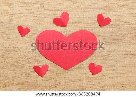 Series of Valentines Card. Six Red heart paper cut on wooden background. Image of Valentines day. - stock photo