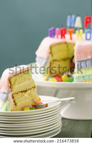 Series on Pinata Cake, a celebration cake with a hidden stash of sweets inside. - stock photo